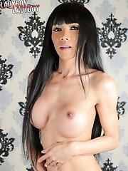 Gorgeous Yammy is a hot slim ladyboy with an amazing body, nice small tits and a rock hard cock!